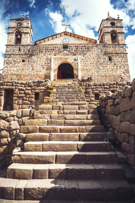 Vertical outdoors shot of stairs of the old church built over Inca temple ruins.