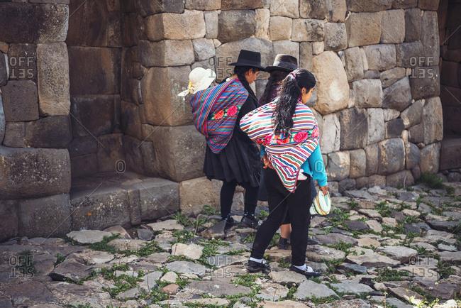 AYACUCHO, PERU - DECEMBER 30, 2016: Back view of group of women walking on stairs in Ayacucho, Peru.