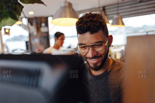 Cashier using cash register in a restaurant