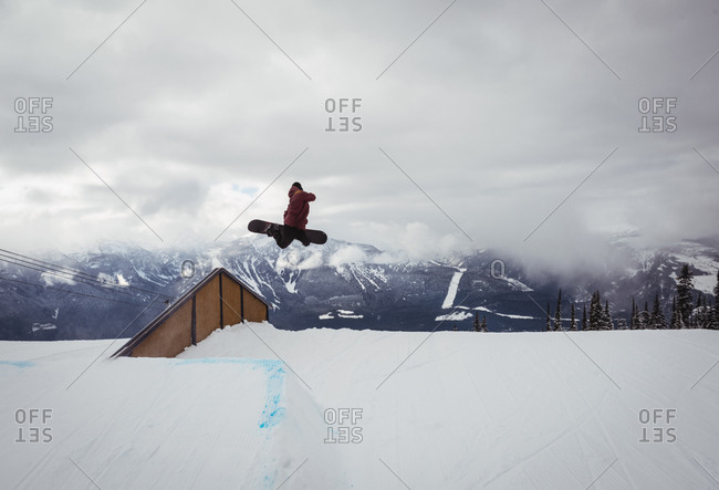 Man skiing on snowy alps in ski resort during winter