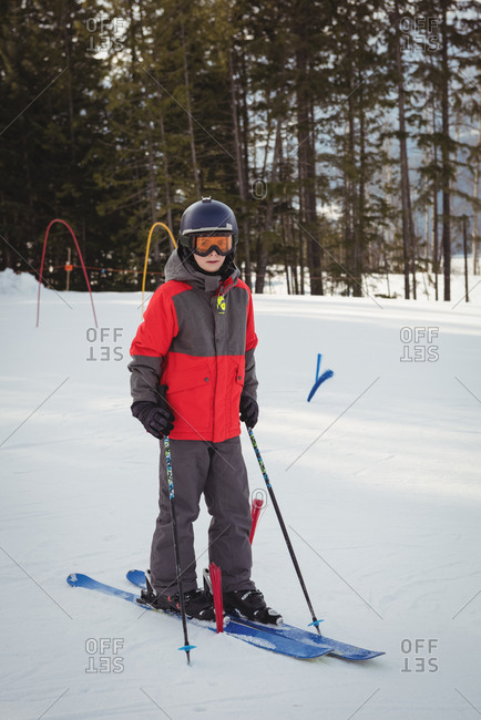 Portrait of boy skiing on snowy alps during winter
