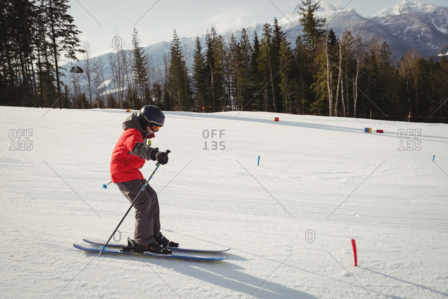 Boy skiing on snowy alps during winter