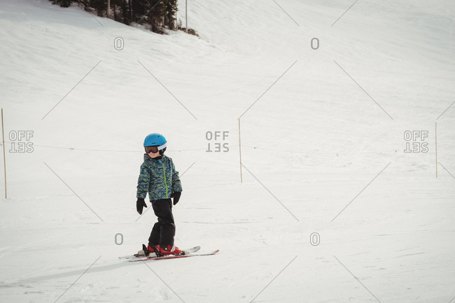 Girl skiing on snowy alps during winter