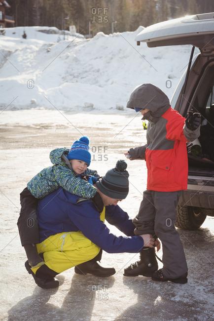 Family preparing for ski during winter
