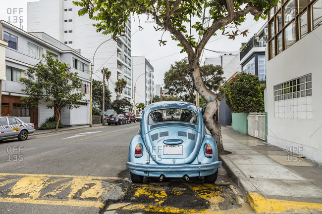 Lima, Peru - August 7, 2016: Classic car parked on a street side in Lima, Peru