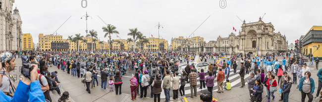 Lima, Peru - August 7, 2016: Spectators lining the streets at a parade in the central governmental square of Lima, Peru