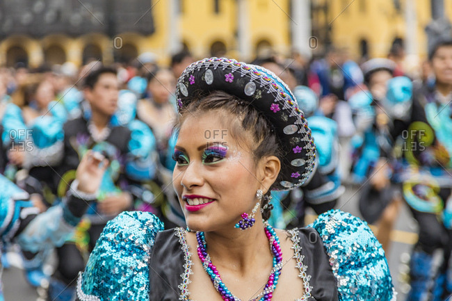 Lima, Peru - August 7, 2016: Dancer with colorful make-up and costume in a parade in Lima, Peru