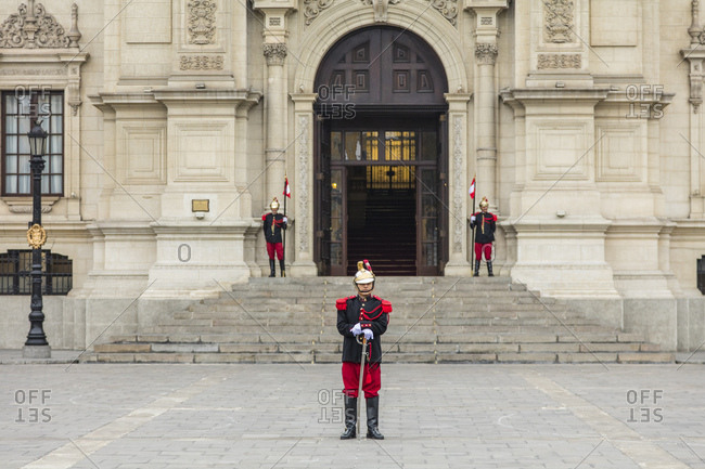 Lima, Peru - August 7, 2016: Presidential guard soldiers standing in front of a governmental building in Lima, Peru.