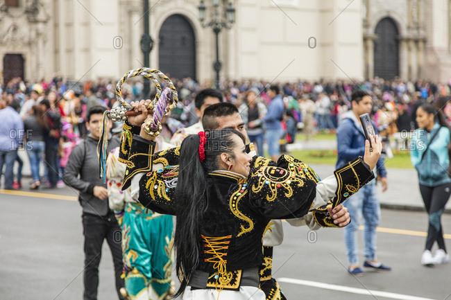 Lima, Peru - August 7, 2016: Dancers taking a selfie together in a parade in Lima, Peru