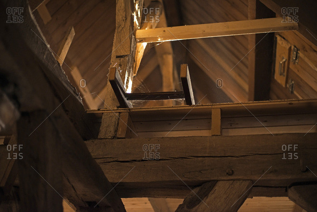 Old wooden ladder in the attic of church.