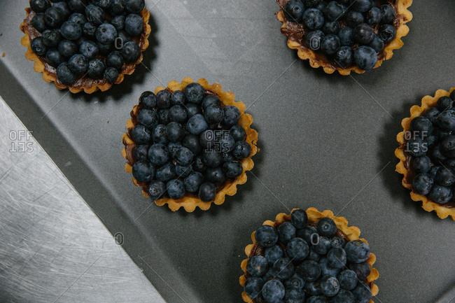 Fresh blueberries in tart shells