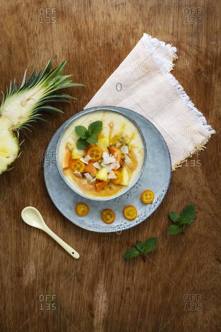 Smoothie Bowl of pineapple - papaya and kumquats