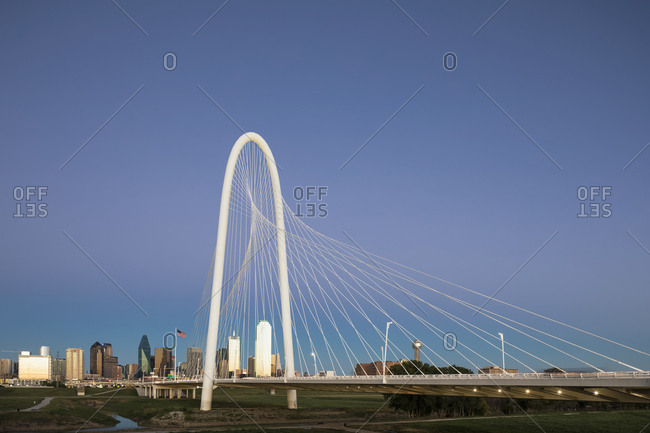 USA, Texas, Dallas - October 20, 2016: Margaret Hunt Hill Bridge and skyline at dusk