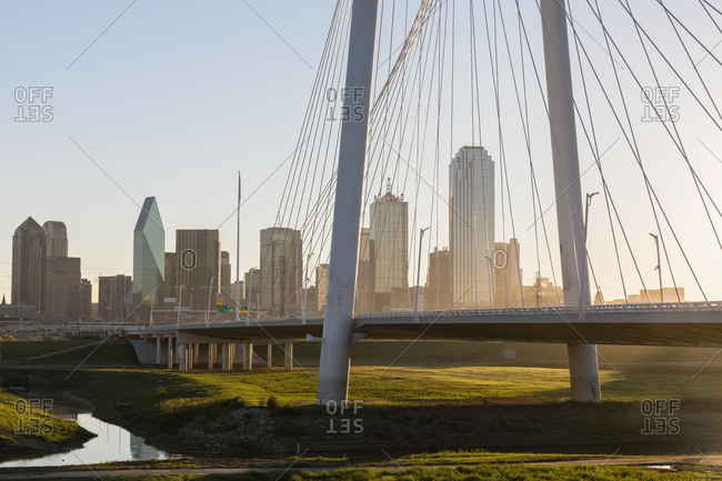 USA, Texas, Dallas - October 21, 2016: Margaret Hunt Hill Bridge and skyline at sunrise