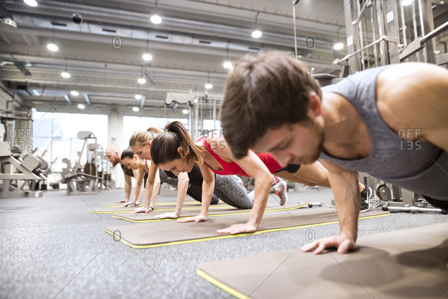 Group of athletes exercising in gym