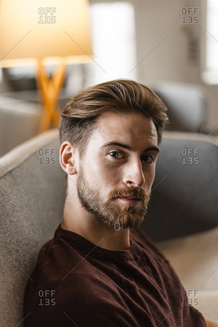 Portrait of young man in a loft