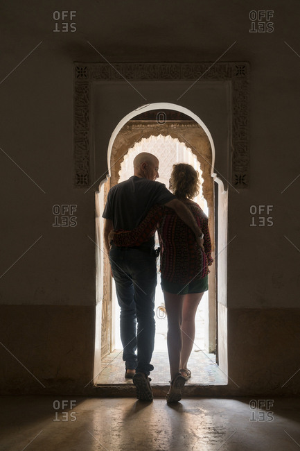 Morocco - Marrakesh - couple leaving building