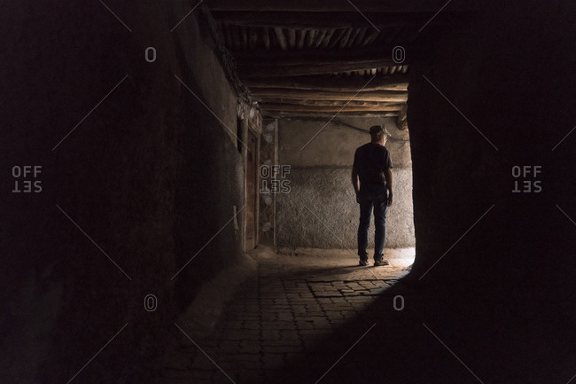 Morocco - Marrakesh - tourist standing in a passageway