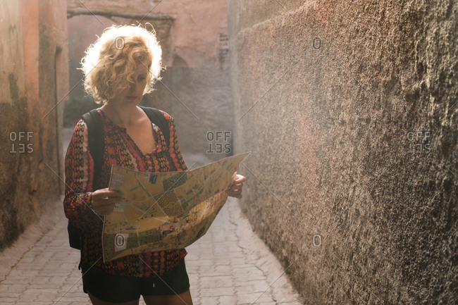 Morocco - Marrakesh - tourist standing in a passageway looking at map