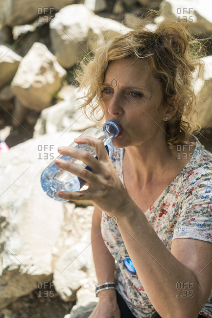 Woman on a trip drinking water from bottle