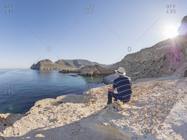 Spain - Andalusia - Cabo de Gata - back view of man looking at the sea