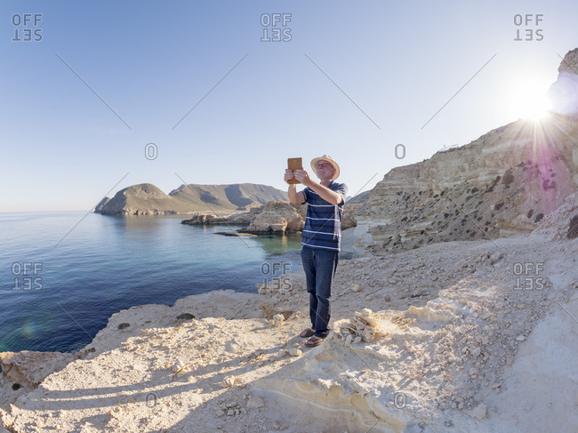 Spain - Andalusia - Cabo de Gata - man taking a selfie at the sea