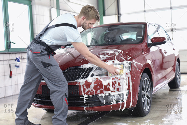 Man cleaning car at car wash