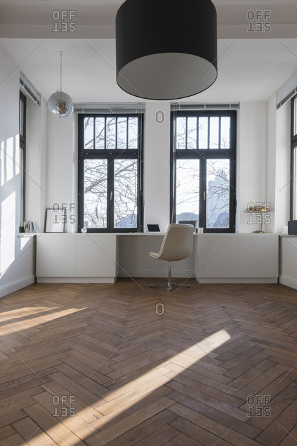 Empty room with chair and large panorama window
