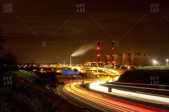 UK - England - West Yorkshire - view to Ferrybridge power station by night with motorway in the foreground