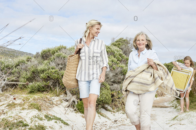 Mother - daughter and grandmother spending a day at the beach