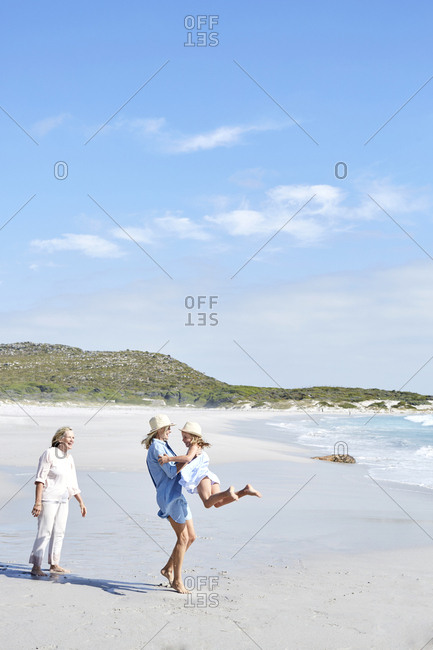 Mother daughter and grandmother spending a day at the beach