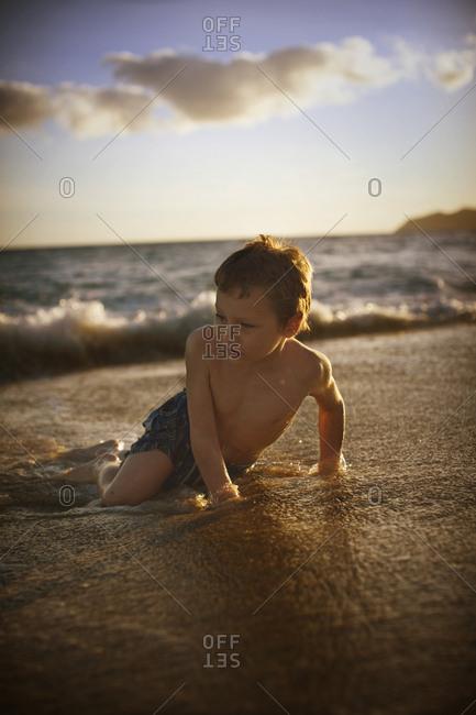 Boy playing on a beach
