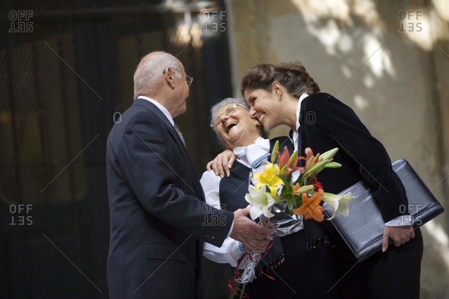 Lawyer smiling with a senior couple