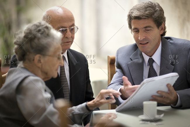 Lawyer speaking to a senior couple