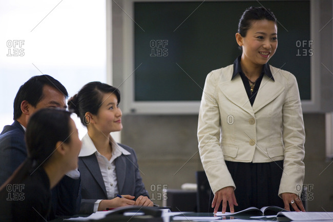 Businesswoman standing to speak in a meeting