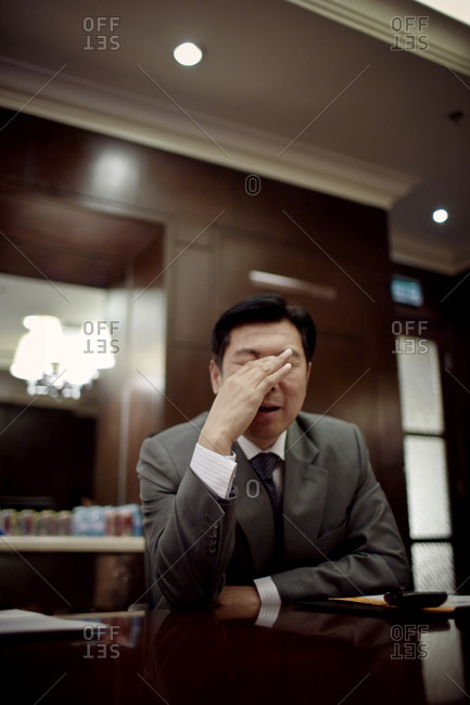 Frustrated businessman in a board room
