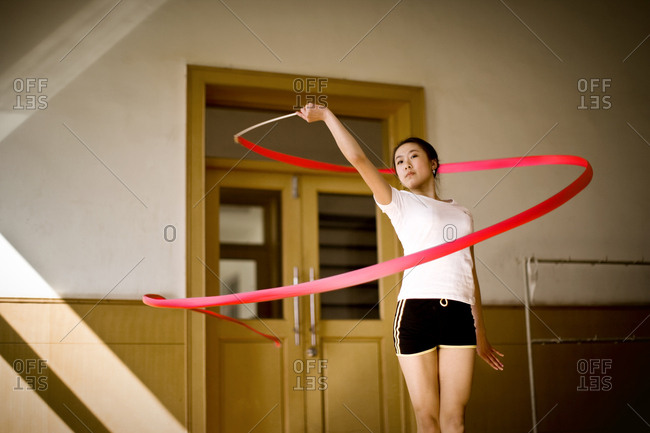 Gymnast practicing with her ribbon
