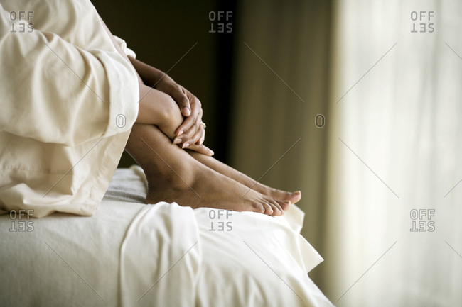 Woman's feet on a bed