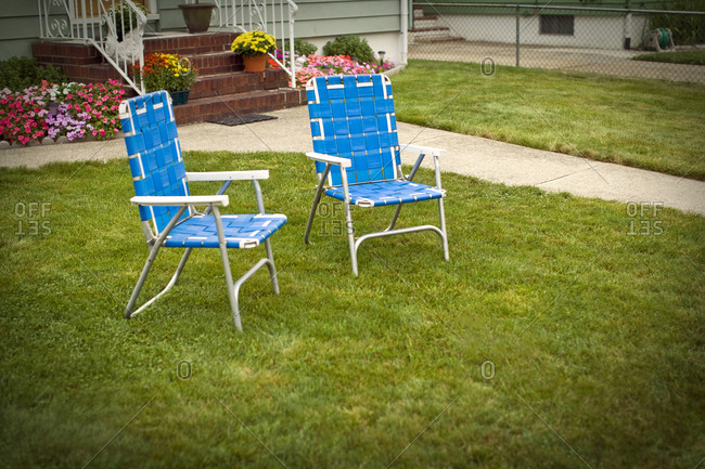 Blue chairs on a lawn
