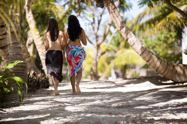 Women wearing sarongs on a road