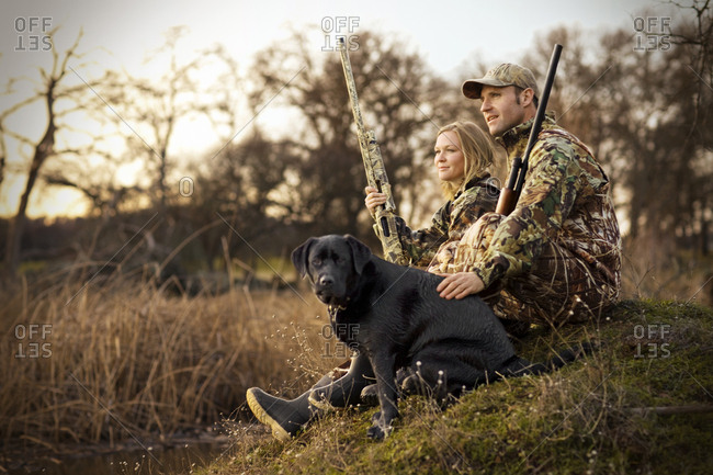 Couple hunting with a dog
