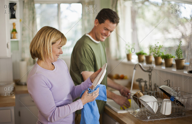 Middle-aged couple dishwashing - Offset Collection