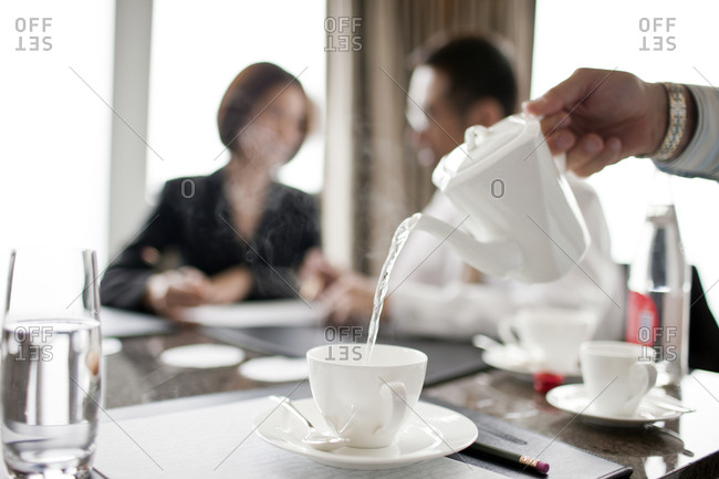 Waiter pouring tea in restaurant