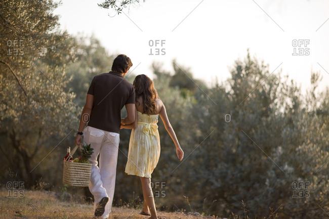 Couple walking with a picnic basket