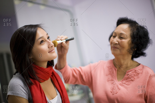 Women applying make-up