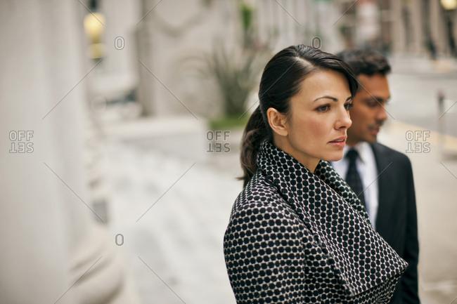 Businesswoman by a pillar