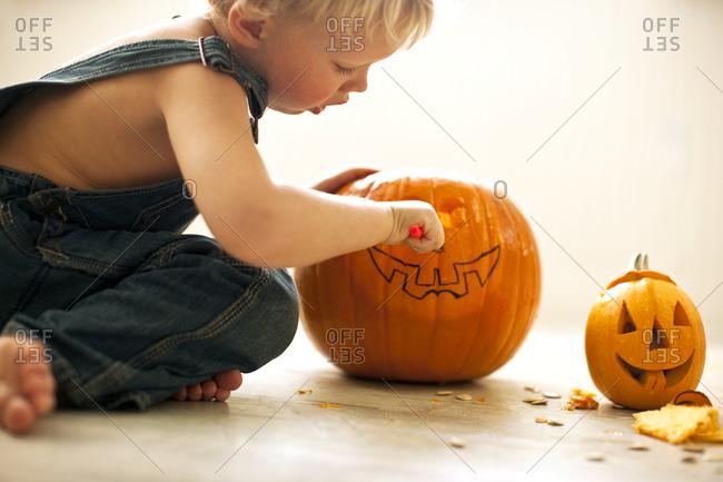 Boy carving jack o' lantern