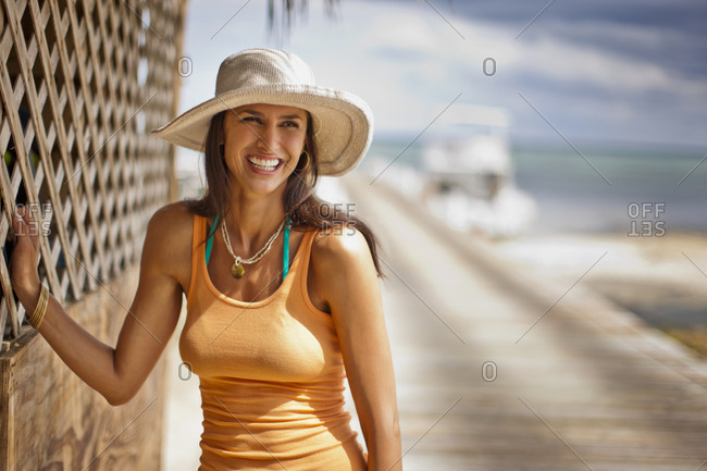 Portrait of a smiling woman in a sun hat