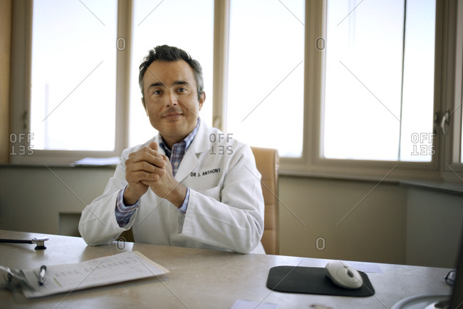 Portrait of a doctor sitting at his desk