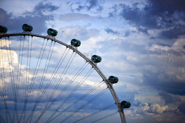 Ferris wheel against a cloudy sky